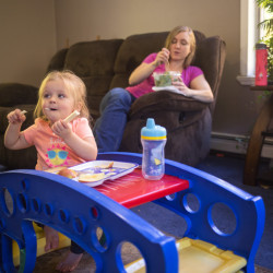 Samantha Watson and her 2-year-old daughter, Audree, eat lunch at home in Parsonsfield. Watson, a 25-year-old single mother, bristles at the idea that recipients of Temporary Assistance for Needy Families are squandering their benefit or that they can't be trusted to spend the money responsibly.