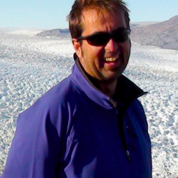 University of Maine climate science researcher Gordon Hamilton spends time on the ice sheet in east Greenland in 2009.