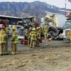 First responders work at the scene of a crash between a tour bus and a semi-truck on Interstate 10 near Desert Hot Springs, near Palm Springs, in California's Mojave Desert, on Sunday. There were multiple deaths and injuries.