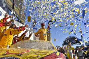 Joey Logano celebrates after his Sprint Cup victory Sunday at Talladega Superspeedway. Logano clinched a spot in the next-to-last round of the playoffs and is one of eight drivers still in contention for the championship.