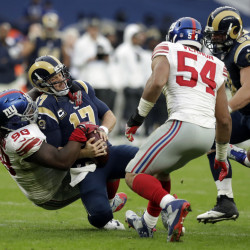 Giants defensive tackle Damon Harrison sacks Rams quarterback Case Keenum, who was intercepted four times Sunday in New York's 17-10 victory in London.