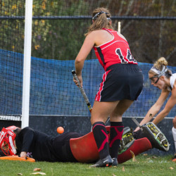 SOUTH BERWICK, ME - OCTOBER 24: Scarborough goalie Sam Carriero is sprawled on the groud as teammate Lucy Bogdanovich (C) and Marshwood's Mallory Nadeau watch the ball go into the net for Marshwood's second goal. Marshwood went on to defeat Scarborough 2-0 in Semi Final action on October 24, 2016.(Photo by Carl D. Walsh)StaffPhotographer)