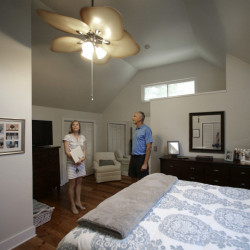 Real estate agent Lauren Newman, left, shows client Steve Martin, a home for sale in Mount Pleasant, S.C. Home sales in the U.S. were up in Augusta according to the Standard & Poor's/Case-Shiller 20-city home price index.