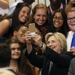 Democratic presidential candidate Hillary Clinton takes a photo with supporters after speaking at Fort Hayes Vocational School in Columbus, Ohio. A new poll finds that young voters are starting to come through for Clinton, particularly among whites ages 18 to 30.