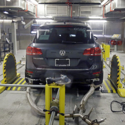 A Volkswagen Touareg with a diesel engine undergoes an emissions test in Michigan. This week's ruling by a federal judge represents the biggest auto-scandal settlement in U.S. history.