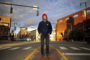 Asher Woodworth was arrested Monday after he adorned himself with tree branches and slowly walked across this intersection at Congress and High streets. He says his performance art was meant to call attention to the contrast between the fast pace of an urban space with the slowness and magic of nature.