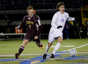 Falmouth's John Mullin drives downfield as Thornton Academy's Keegan Fowler moves in on defense during a boys' soccer game Tuesday at Falmouth High. Falmouth won, 2-0. (Photo by Shawn Patrick Ouellette/Staff Photographer)
