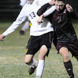 Maranacook's Silas Mohlar, left, and Freeport's Jesse Bennell tangle as they chase a ball during a Class B South quarterfinal Tuesday at the Ricky Gibson Field of Dreams in Readfield. The Black Bears scored five times in the second half to earn a 5-0 win and advance to the regional semifinals.