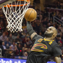 LeBron James, rising for a dunk, finished with 19 points, 11 rebounds and 14 assists Tuesday night for the Cleveland Cavaliers in a 117-88 victory against the New York Knicks.