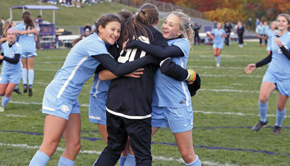 Windham High players swarm goalkeeper Kaitlyn Roberts after the Eagles beat Cheverus, 3-1, in a Class A South girls' soccer quarterfinal Wednesday in Portland. (Photo by Ben McCanna/Staff Photographer)