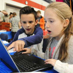 Adam Metcalf, left, and Amelia Jackson, fourth-graders from Adams School in Castine, enter vote tallies into a laptop during the Secretary of State Office's Student Mock Election event Wednesday at the Augusta Armory.