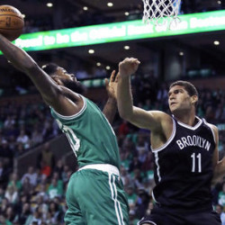 Boston's Amir Johnson, left, grabs a rebound over Brooklyn's Brook Lopez in the first quarter of Wednesday's opener at Boston.
