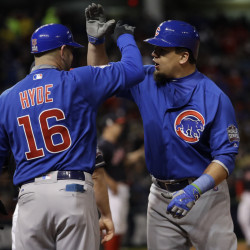Kyle Schwarber of the Cubs is congratulated by first-base coach Brandon Hyde after hitting an RBI single in the fifth inning of Game 2 of the World Series Wednesday night against the Cleveland Indians.