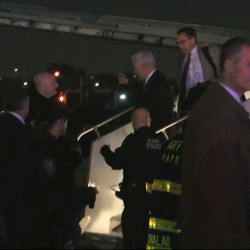 Republican vice presidential candidate Mike Pence walks down the steps of his campaign plane at New York's LaGuardia Airport on Thursday after it slid off the runway while landing.