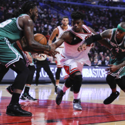 Jimmy Butler of the Bulls, center, battles for a ball with Boston's Jae Crowder, left, and Isaiah Thomas in the second quarter of Thursday's game at Chicago.