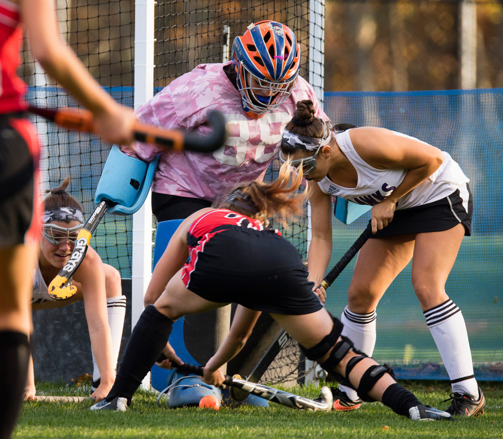 Marshwood goalie Shannon Giblin kicks the ball out while getting support from teammates as Scarborough's Ashley Levesque tries to score in Friday's playoff game. Marshwood went on to defeat Scarborough, 2-0, in a Class A semifinal game.