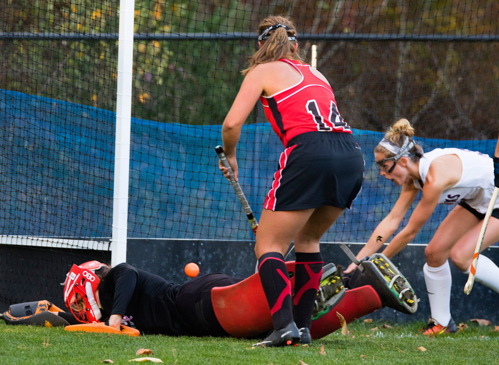 Scarborough goalie Sam Carriero sprawls as teammate Lucy Bogdanovich and Marshwood's Mallory Nadeau watch the ball go into the net for Marshwood's second goal.