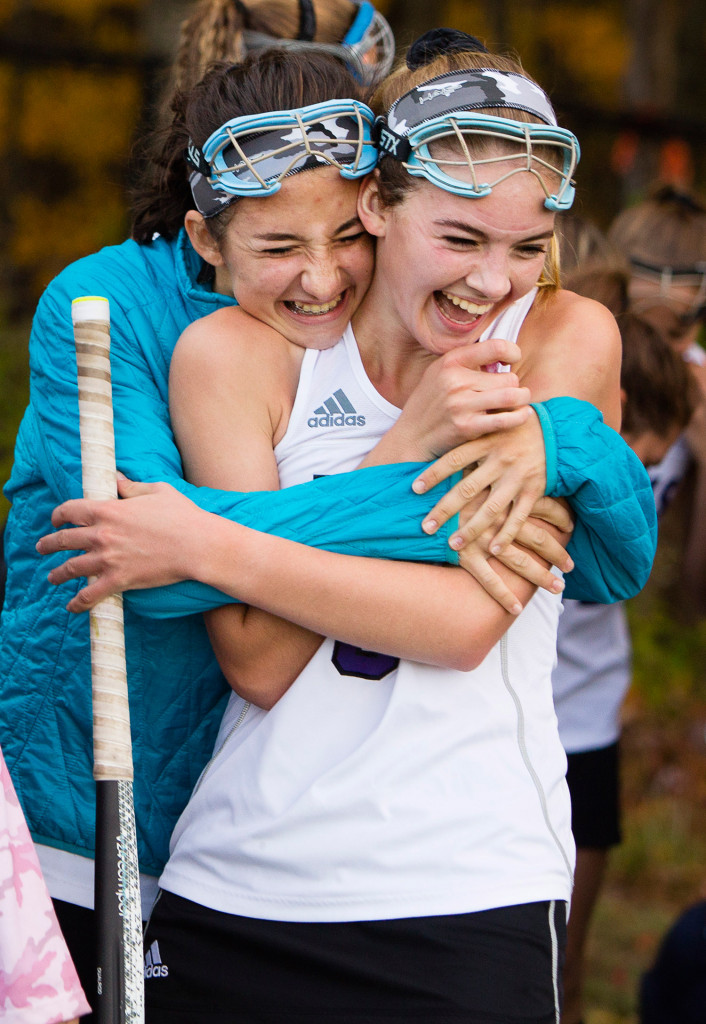 Marshwood's Madison Pearson, left, hugs teammate Morgan Hasty after their 2-0 win over Scarborough in Monday's Class A semifinal game.