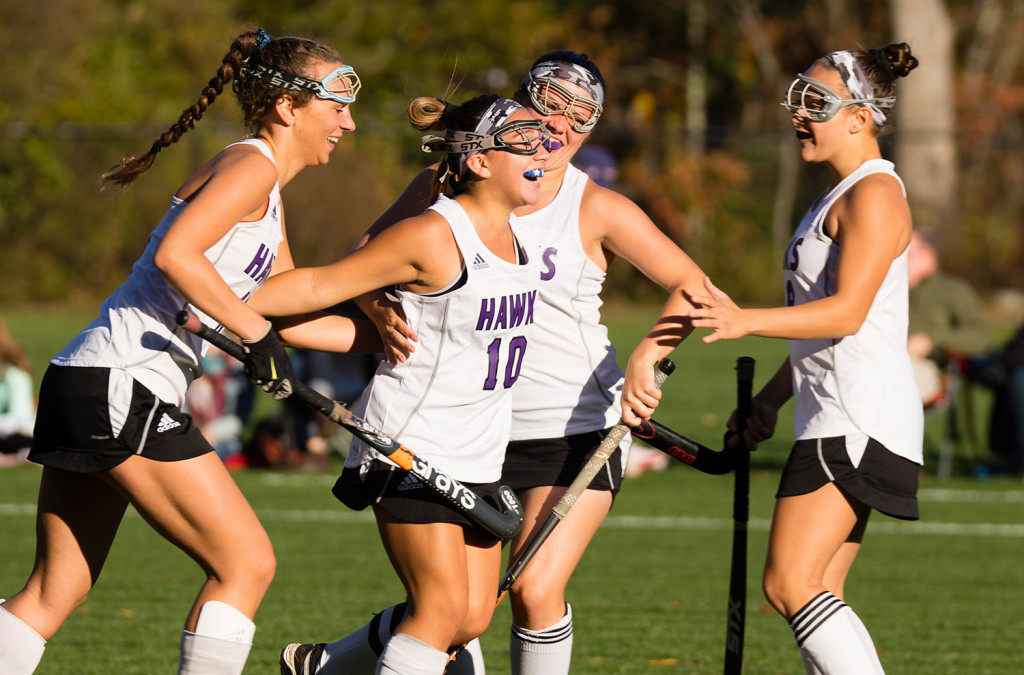 Marshwood players celebrate their first goal of Monday's semifinal game against Scarborough. The goal proved to be the game winner.