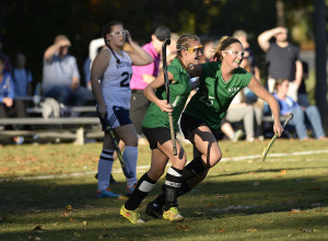Massabesic's Emma Desrochers, left, and Jacklyn Bearse celebrate after Desrochers scored the game's first goal in the first half Wednesday in a Class A South field hockey quarterfinal at Westbrook.