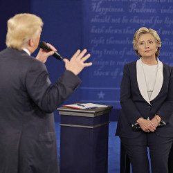 Hillary Clinton listens to  Donald Trump during the second presidential debate on Oct. 9, 2016,  in St. Louis. National polls have moved in Clinton's direction since the exchanges began in late September. Associated Press/John Locher