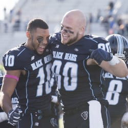 UMaine's Micah Wright and Jeremy Salmon celebrate ta win over Albany on Saturday at Orono.