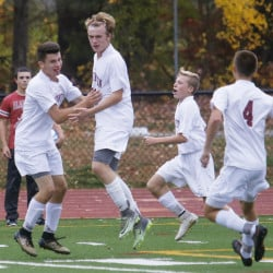 Thornton Academy players celebrate a first-half goal by Noah Niles, second from left, in the first half.