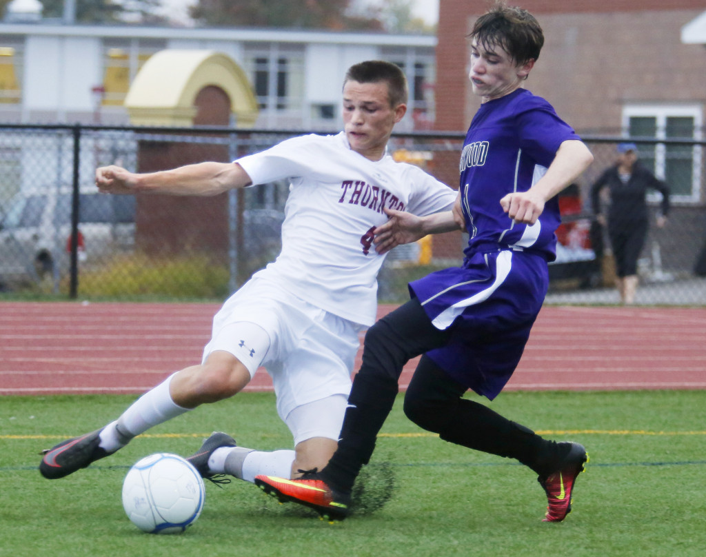 Ben Steva of Thornton Academy tries to cross the ball as Mike LaSelva of Marshwood defends in the first half.