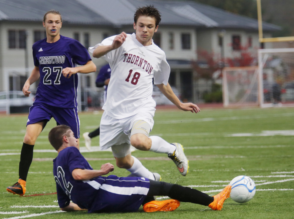 Henry Herbold of Marshwood slides to knock the ball away from Noah Edborg of Thornton Academy in the second half.