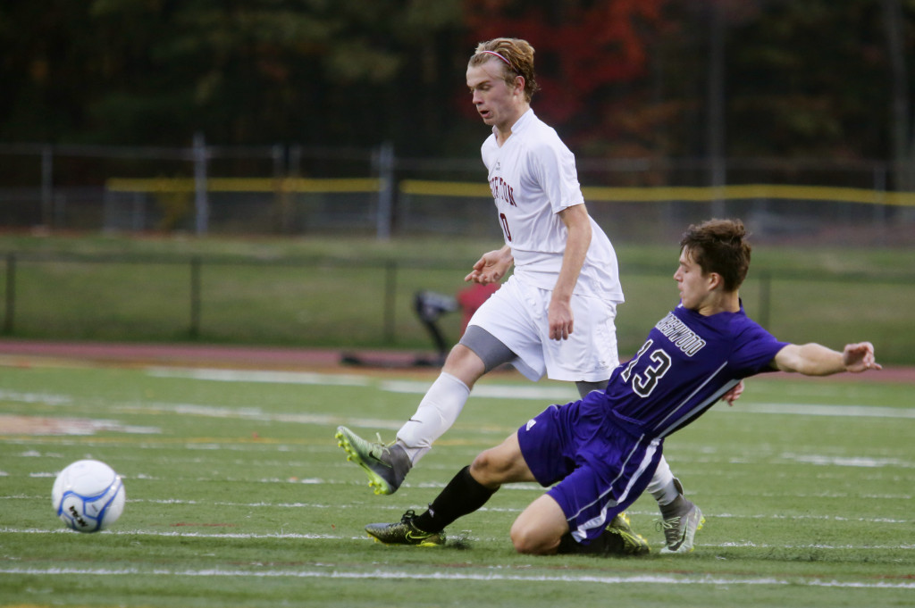 Noah Niles of Thornton Academy passes the ball as Riley Dinsmore-Patch of Marshwood defends in the first half.