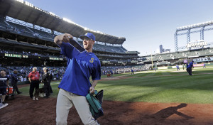Seattle Mariners pitcher Charlie Furbush tosses memorabilia to fans after the team's final baseball game of the season on Sunday, Oct. 4, 2015, in Seattle.