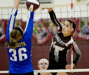 CUMBERLAND, ME - OCTOBER, 26: Greely's Molly Chapin spikes the ball past falmouth's Malia White at Greely in volleyball Wednesday, October 26, 2016.  (Photo by Shawn Patrick Ouellette/Staff Photographer)
