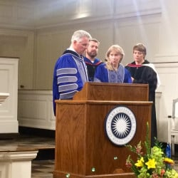Colby College President David Greene, left, presents New York Times journalist Alissa Rubin, right, with an honorary degree and the Elijah Parish Lovejoy Award Monday night at Lorimer Chapel at Colby.