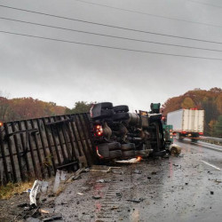 A tractor-trailer truck carrying U.S. mail rolled over Friday morning on Interstate 95 north, near mile 114 in Augusta, backing up highway traffic.