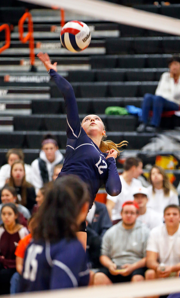 Yarmouth captain Alison Clark elevates to take a shot against Biddeford during the volleyball quarterfinal playoff.