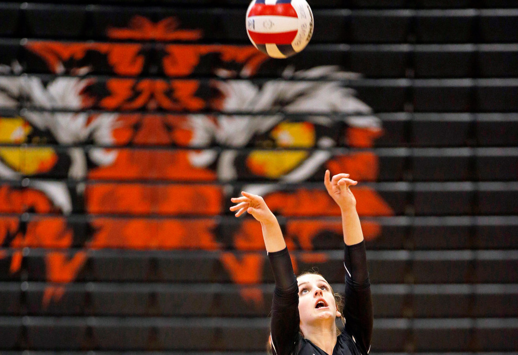 Biddeford captain Megan Friel sets up the ball in the volleyball quarterfinal playoff game against Yarmouth.