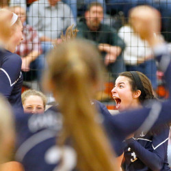 Yarmouth's Marie LeBlanc celebrates with teammates after the winning point was scored against Biddeford in the volleyball quarterfinal playoff game.