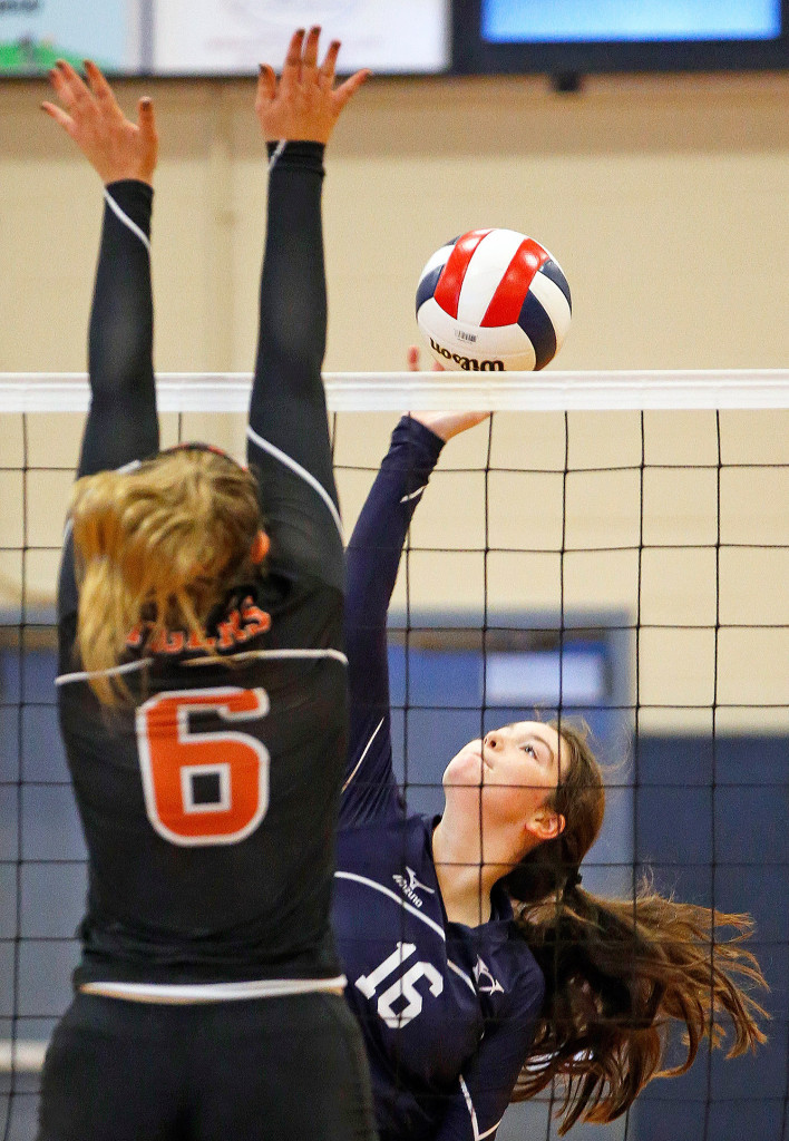 Yarmouth's Ceanne Lyon spikes the ball during the Class A volleyball quarterfinal playoff against at Biddeford on Saturday.