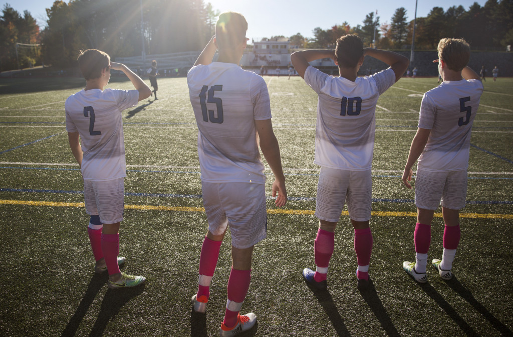 From left, St. Joseph's College players, Mitchell Duncan, Austin Bell, Jesse Ramirez and Jackson Taylor watch the game against Suffolk University while waiting to sub in.