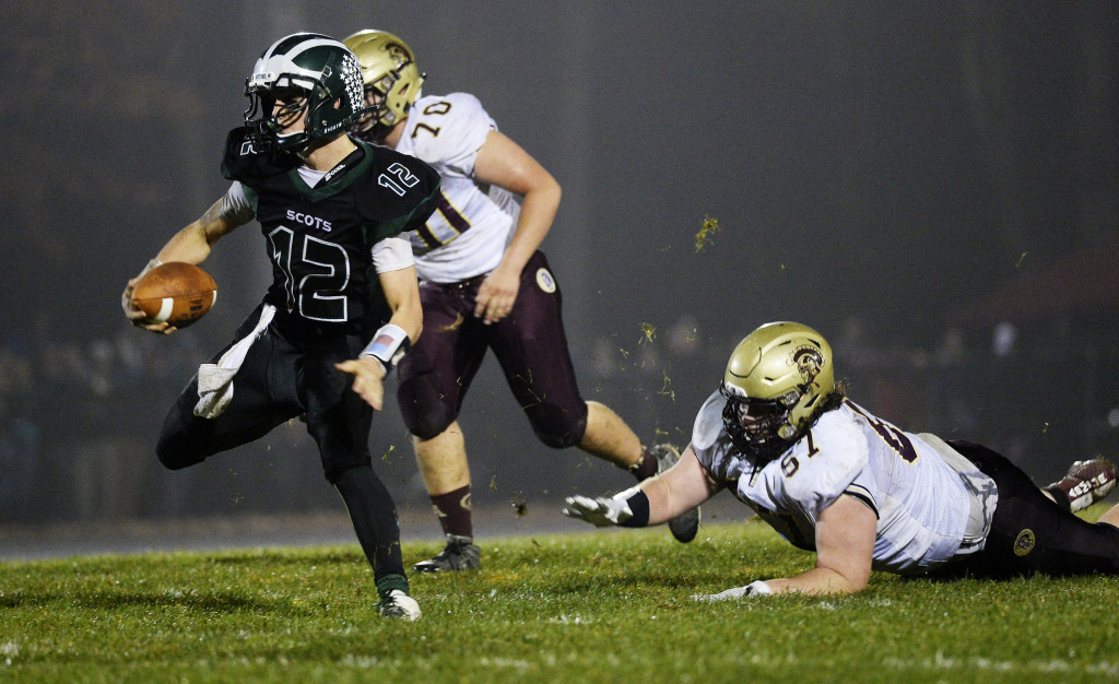 Bonny Eagle's Cam Day finds some running room as he eludes Thornton Academy's Kyle Holman.