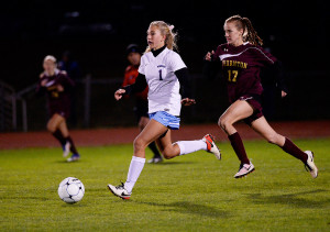 Windham's Alanna Joyce drives with the ball as Thornton Academy's Allie Gross moves in on defense in Monday night's game at Windham. The Eagles advanced in the playoffs with a 4-1 win.