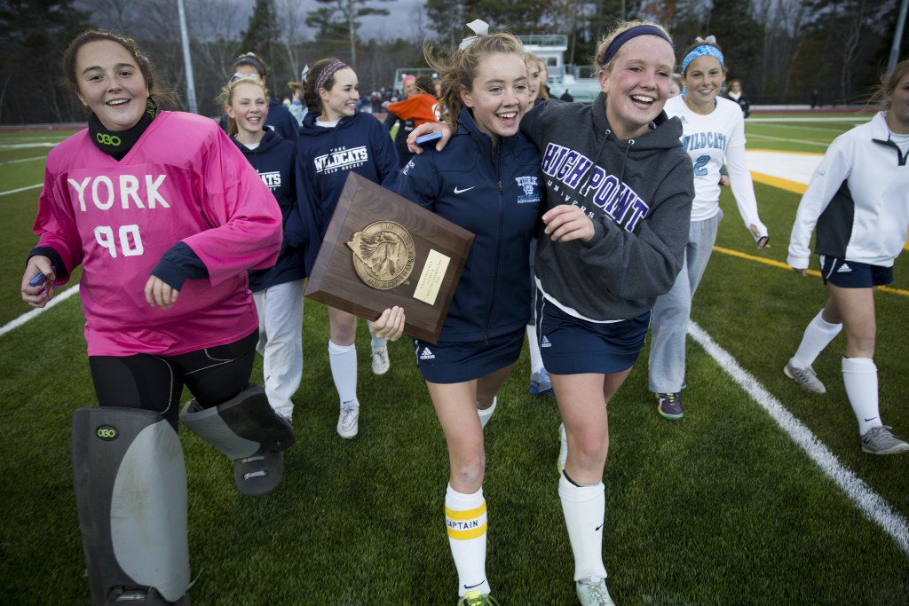 York players hold the championship plaque after winning the Class B South field hockey regional championship.
