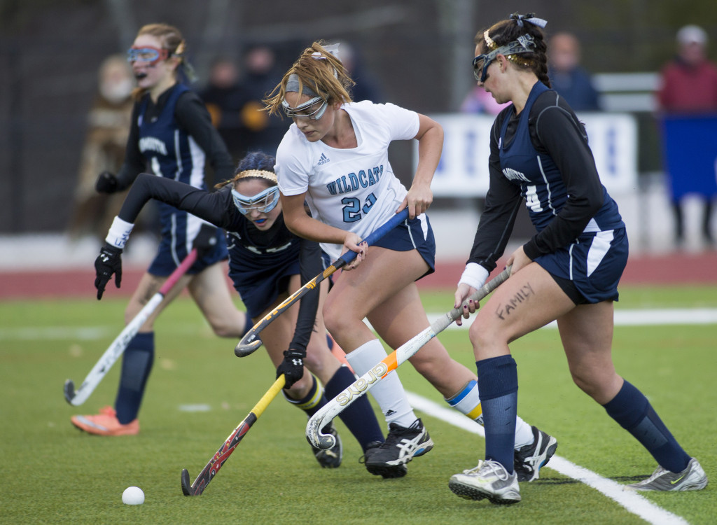 York's Lily Posternak runs with the ball followed by a group of Yarmouth players.