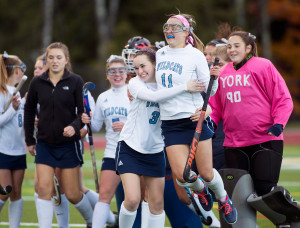 WATERBORO, ME - OCTOBER 26: York senior Brigitte Spencer (3) and sophomore Caroline Leal (11) celebrate after winning the Class B South field hockey regional championship against Yarmouth at Massabesic High School. York won 2-1. (Photo by Brianna Soukup/Staff Photographer)