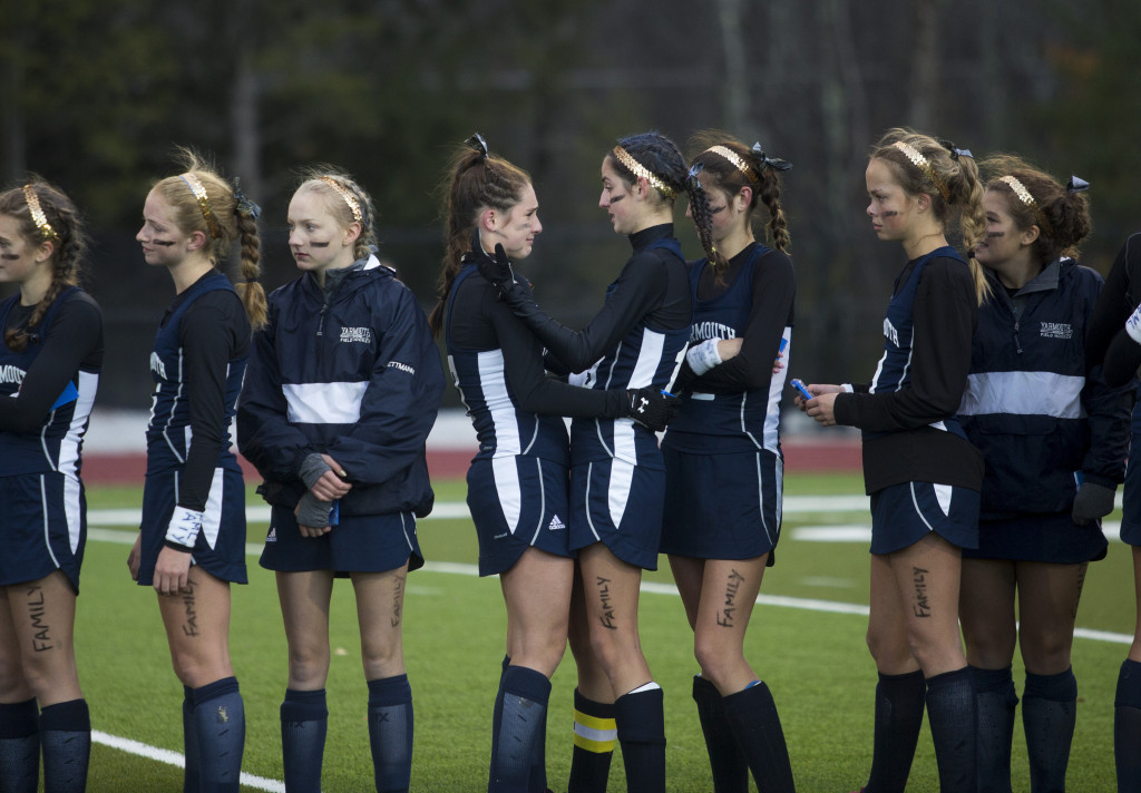 Yarmouth players console one another while waiting for their runner-up plaque.