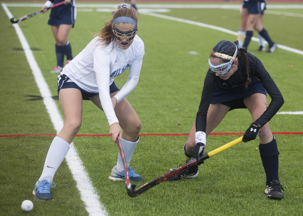 York's Julia Harrod left, and Yarmouth's Nicole McDowell fight for control of the ball.