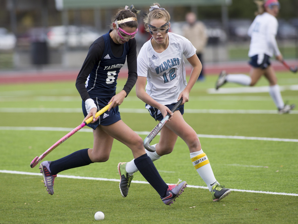 Yarmouth's Abby McDowell  runs with the ball while closely defend by York's Alexandra Lawlor.