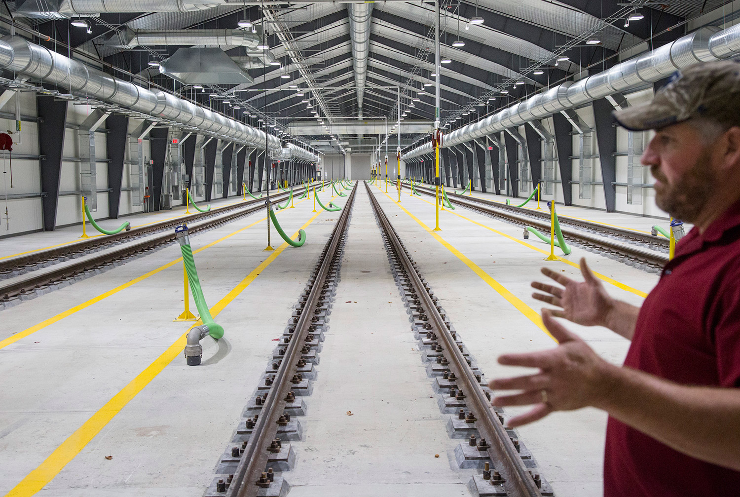 Jim Russell of the Northern New England Passenger Rail Authority gives a tour of the new train shed in Brunswick on Thursday. Longer than two football fields, it will become fully operational Nov. 21. Derek Davis/Staff Photographer