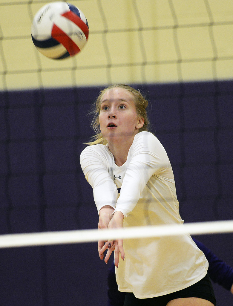 Emily Haley of Cheverus receives a serve from Gorham.