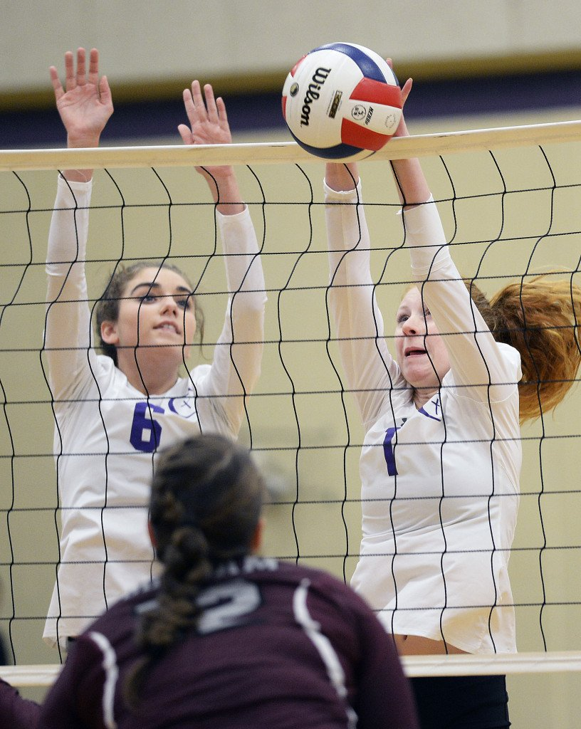 Anna Olore and Alexis Parsons of Cheverus block a shot from Gorham.